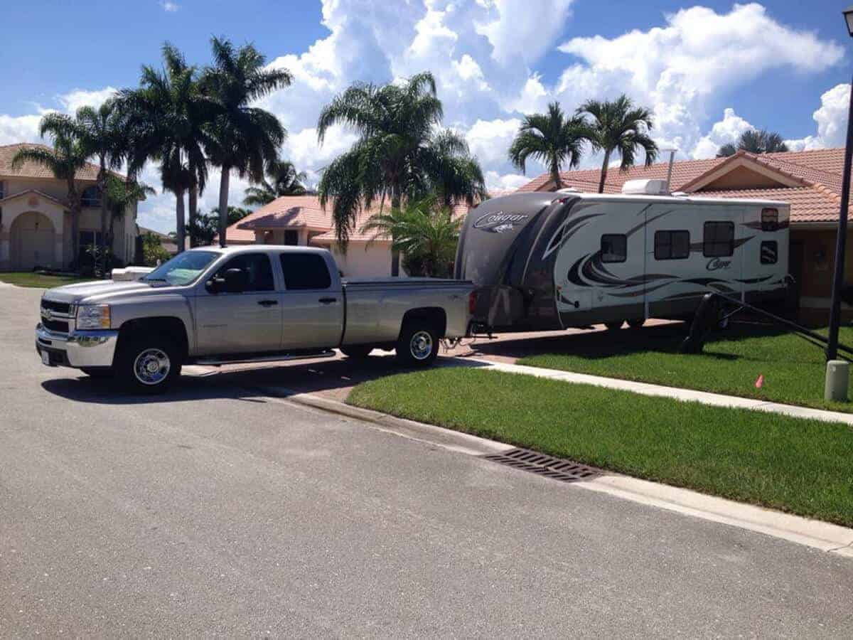 silver truck and travel trailer