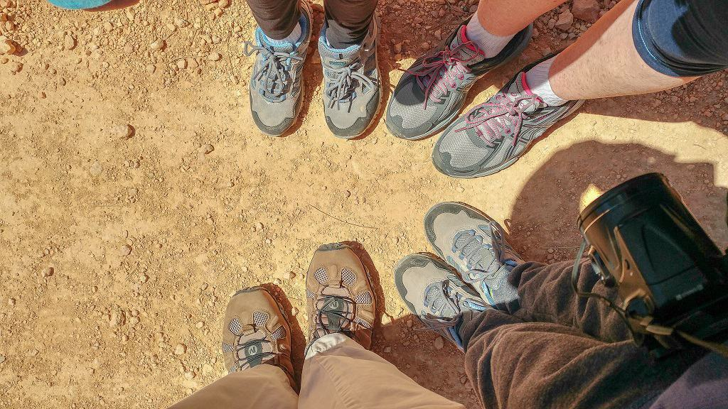 four sets of feet with new hiking shoes