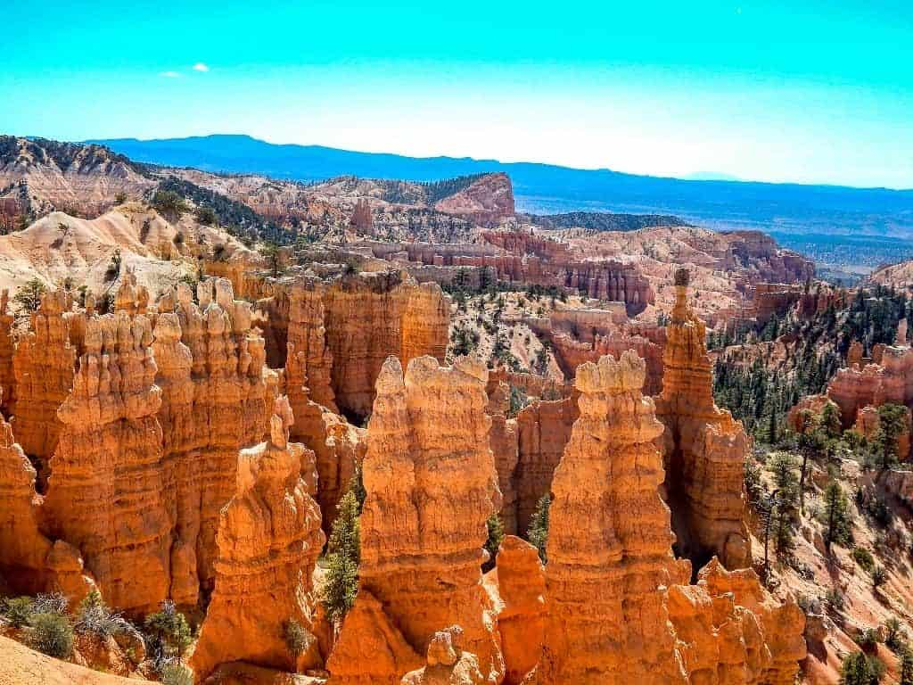 Looking down on the orange hoodoos at bryce canyon national park with the blue sky overhead