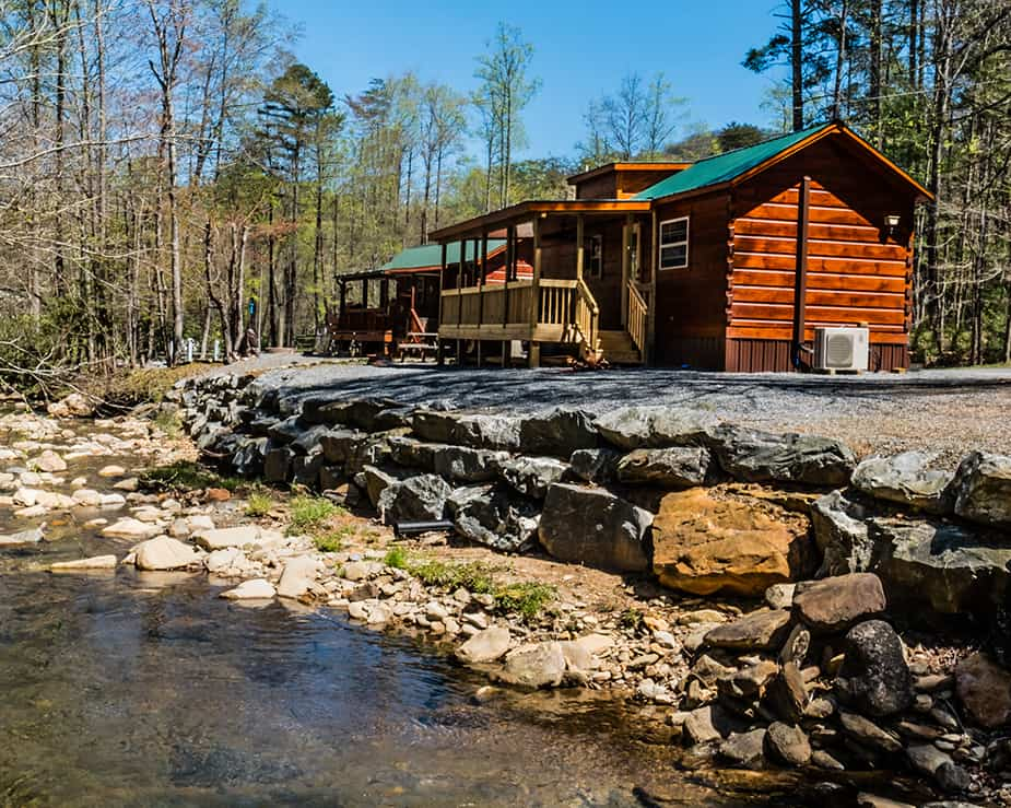 Cabins on the lake with a stream running through