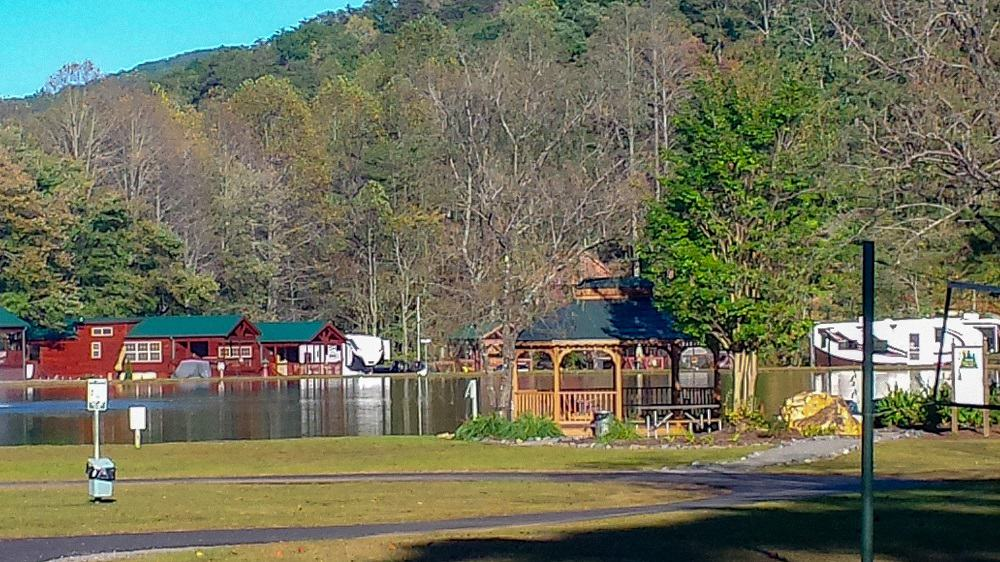 RV Campground in Northern Georgia surrounded by orange and green trees with a lake running through the middle.