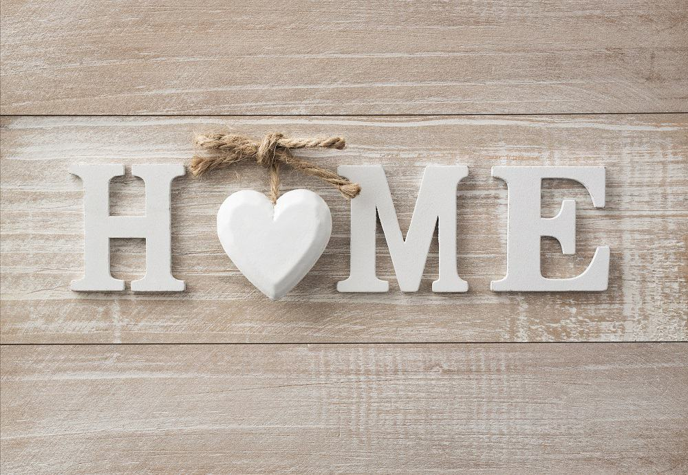 A home sign with a heart in the middle to hang on your wall