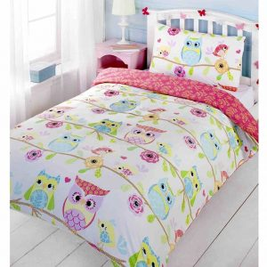 A beautiful pink owl duvet with different owls printed all over the duvet