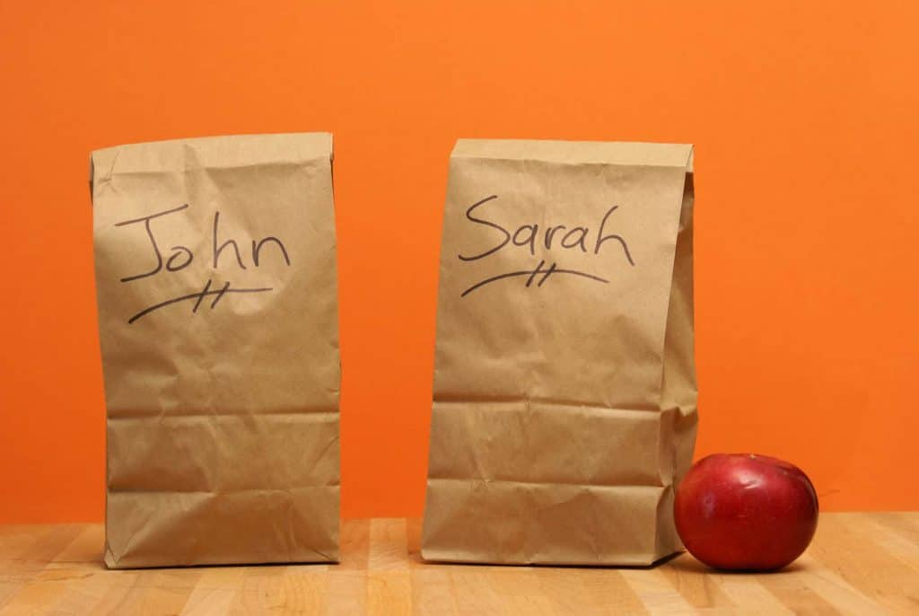 brown lunch bags with names on them as goodie bags on the long road trip.