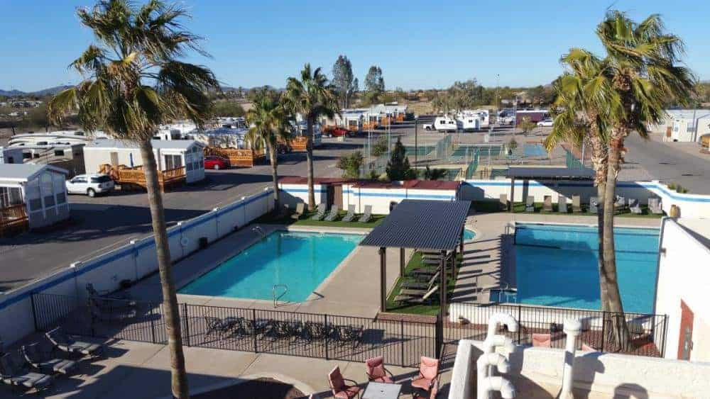 view of pools area in the foreground and rv sites in the background rv living at casa grande rv resort