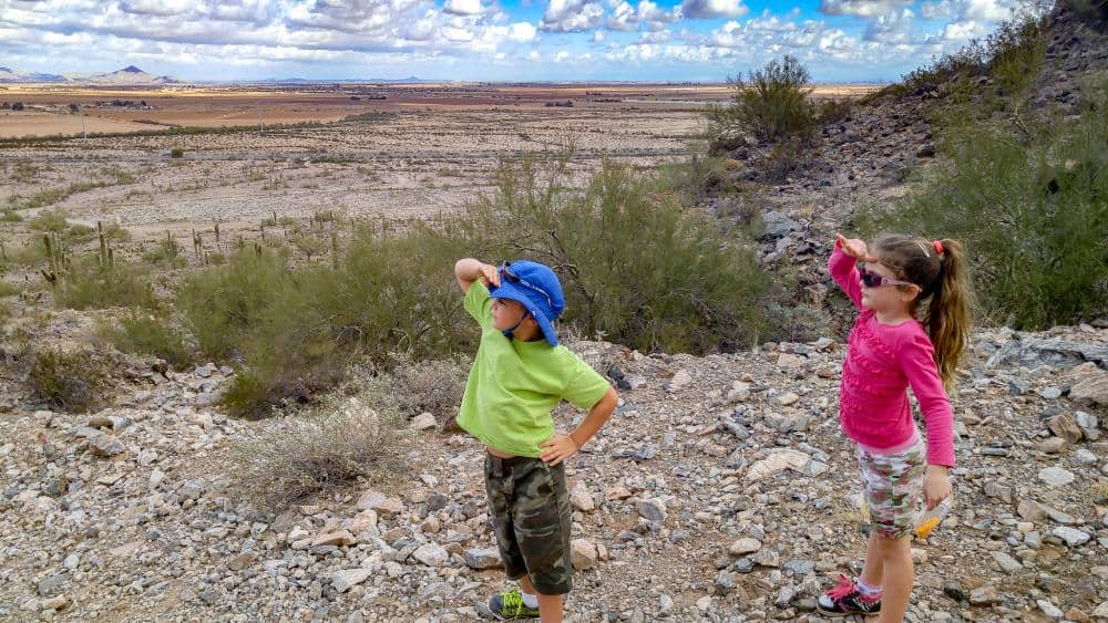 boy and girl hiking in the desert rv living near casa grande arizona