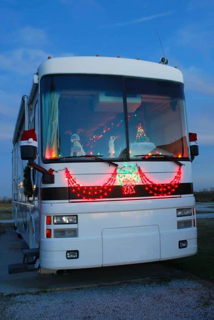 Red Christmas decorations all over an RV