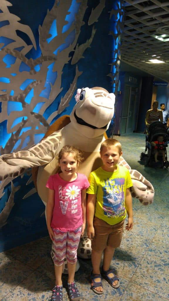 A boy and girl with a pretend sea turtle
