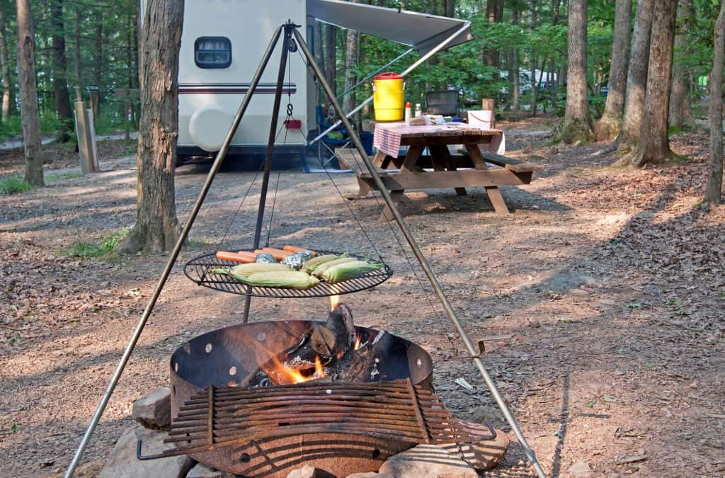 Cooking dinner over a campfire outside RV