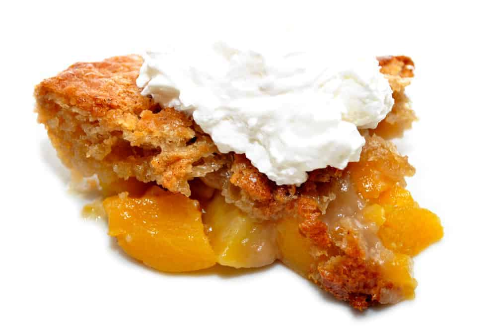 peach dutch oven cobbler with ice cream