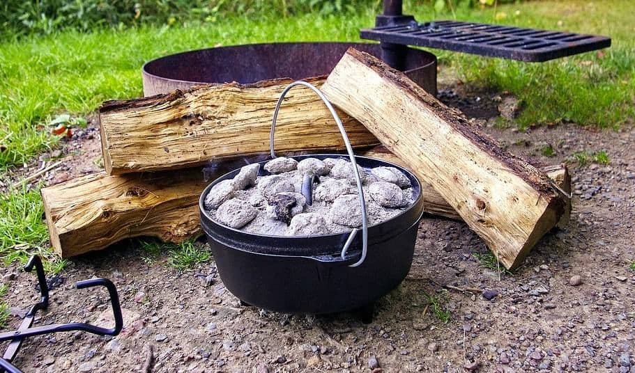 dutch oven with coals and wood