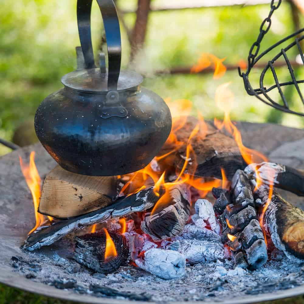 Cooking a kettle over a campfire to make easy RV meals