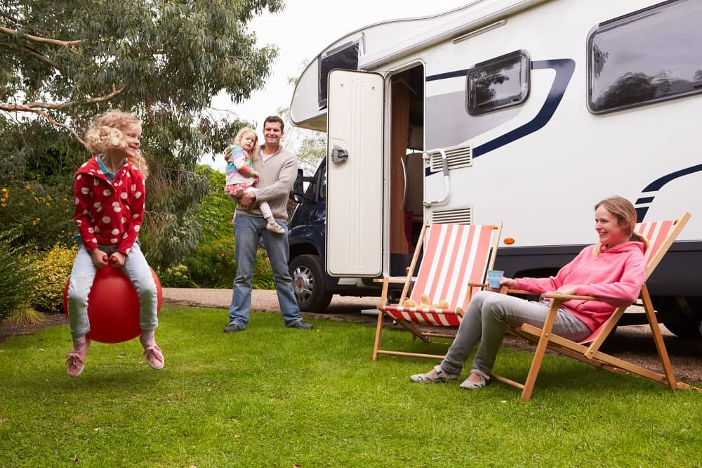family having fun outside rented rv