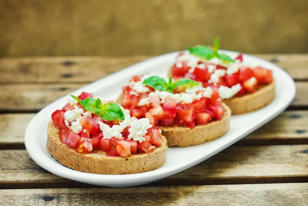 Bruschetta on crusty bread camping lunch no-cook camping meals
