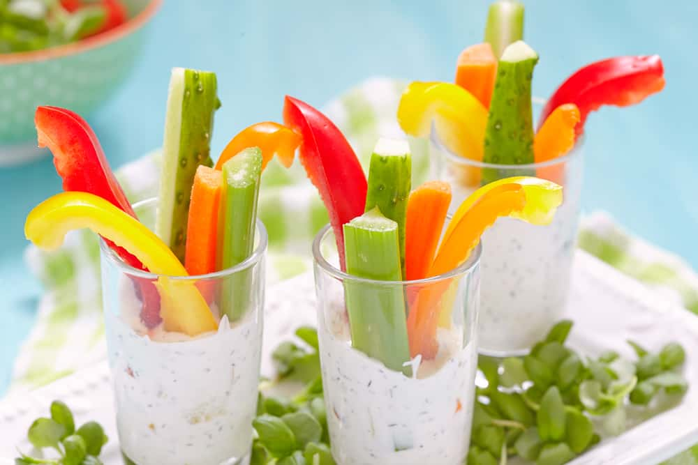 Red, yellow and green peppers that are perfect for camping food no-cook