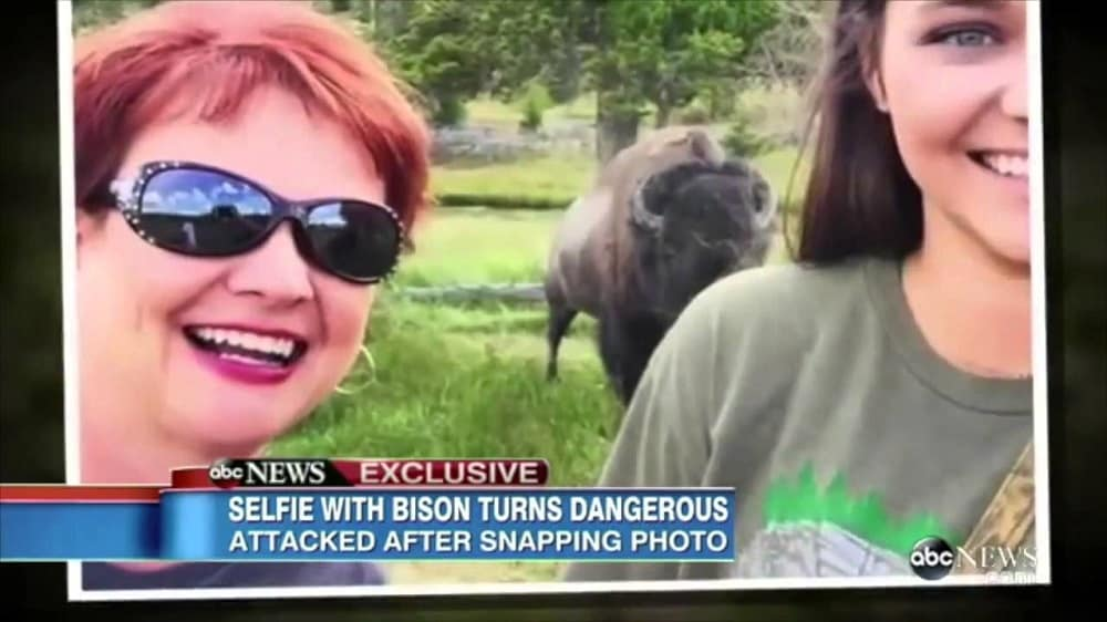 women in selfie with bison