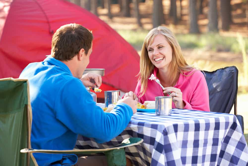 camping food couple eating at table