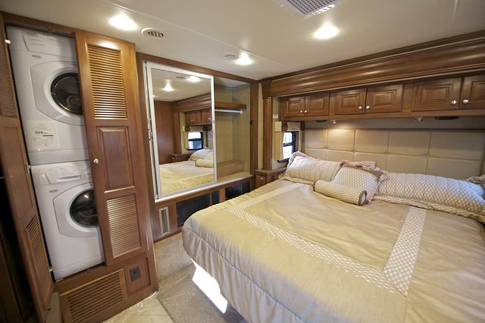 Organized RV bedroom with washer and dryer