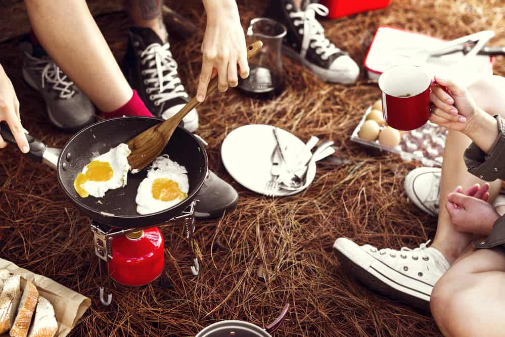 Easy Camping Meals with peoples feet and eggs