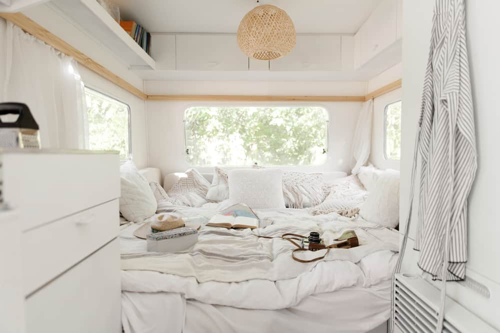 RV bedroom in a small camper