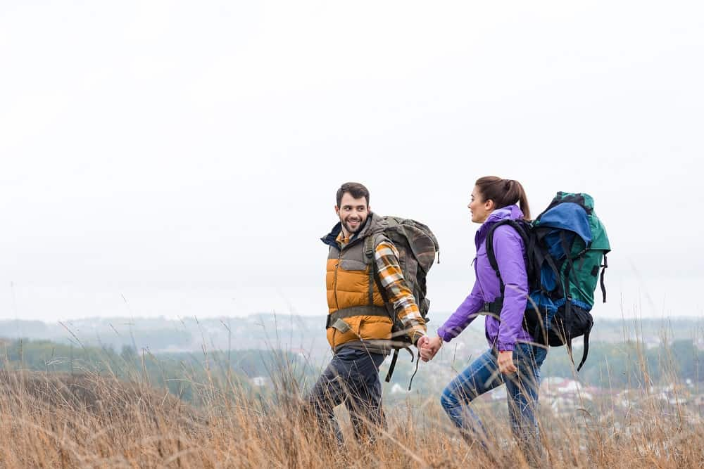 A couple out hiking on trails