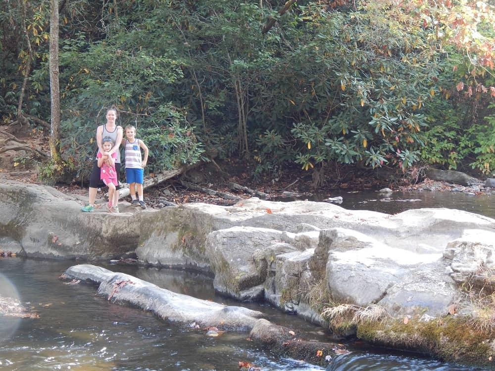 Kids and mom standing on a hiking trail