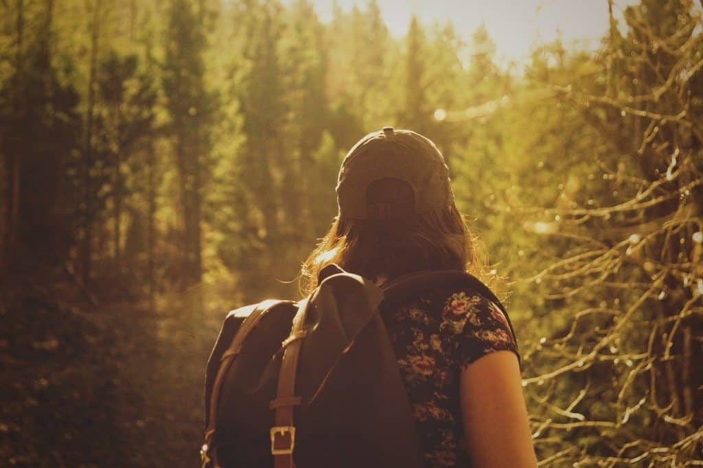 Woman hiking through a wooded area
