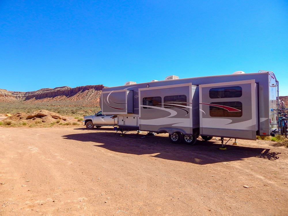 An RV parked in the dessert