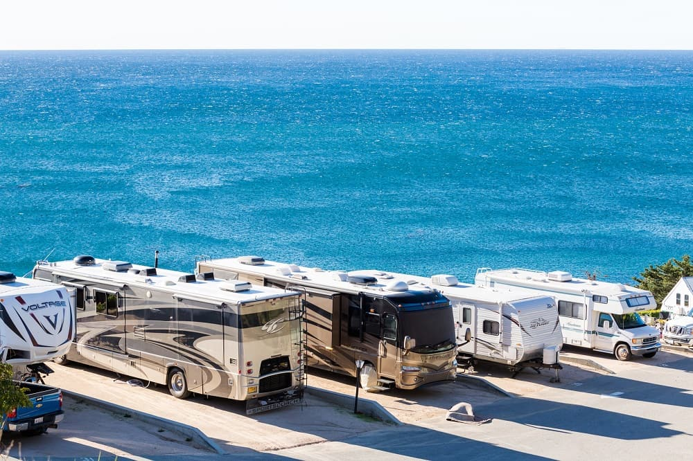 Driving RVs parked on the beach