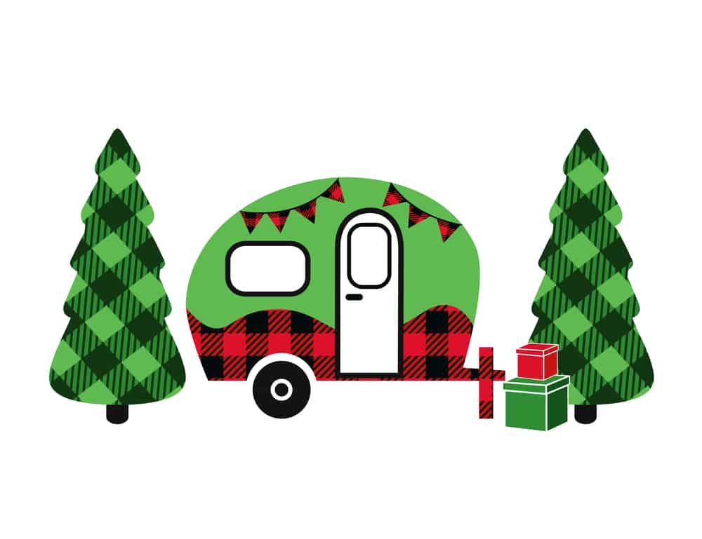 A cute vintage rv in green and red with plaid green trees