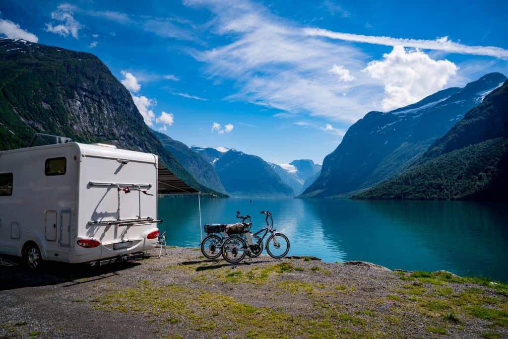 an RV parked at a lake