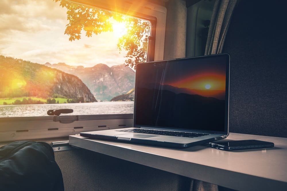 Laptop Computer on a Camper Table with Scenic View.
