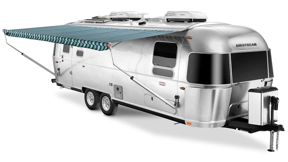 airstream with awning and twin beds