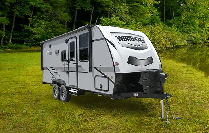 Travel trailer sitting on grass