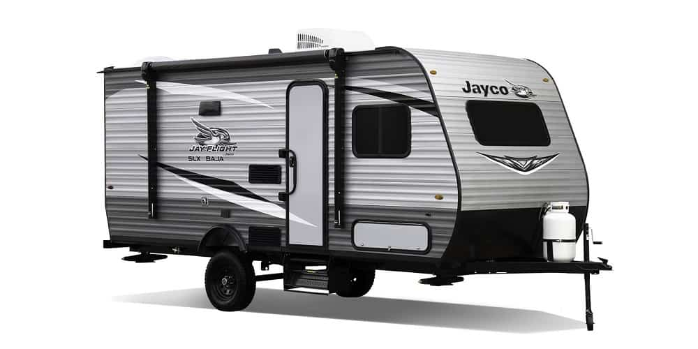 Brown colored travel trailer with 2 beds