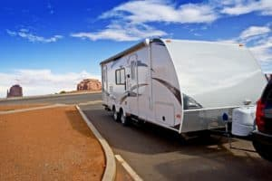 A travel trailer parked in the desert