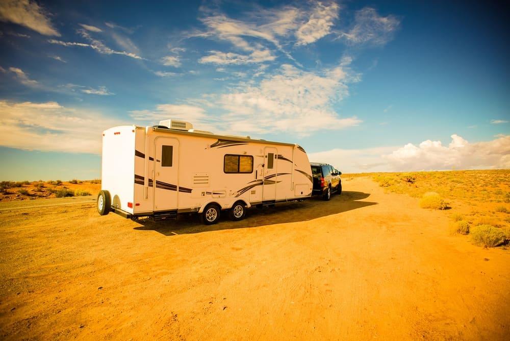 Truck and travel trailer driving through Arizona