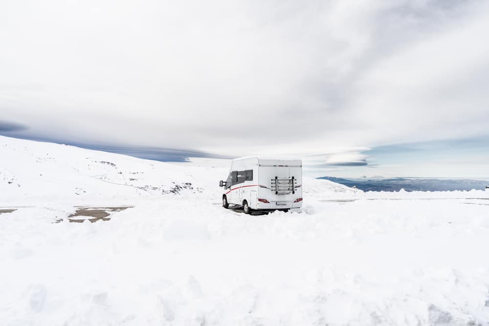 camper stuck in snow in the winter