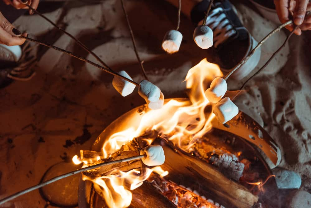 Marshmallows cooking over a portable fire pit