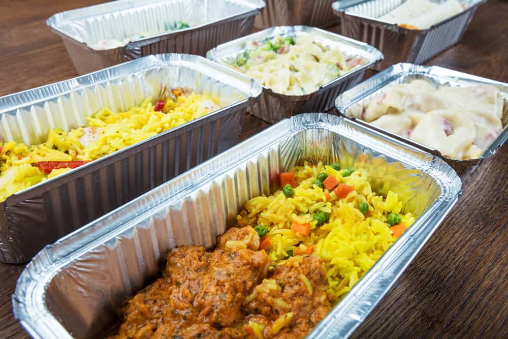 Rice and chicken in take away foil containers